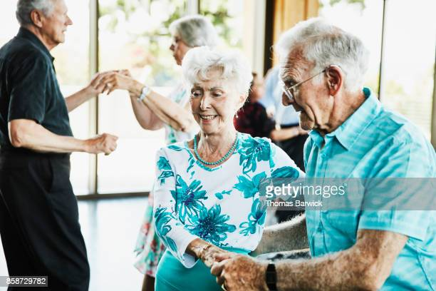 Senior couple dancing together during dance in community center