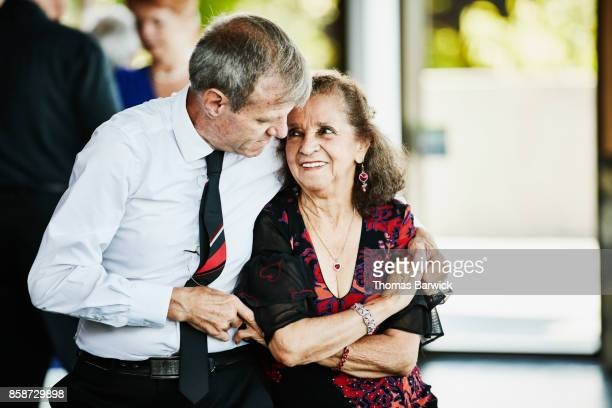 Senior couple dancing together in ballroom