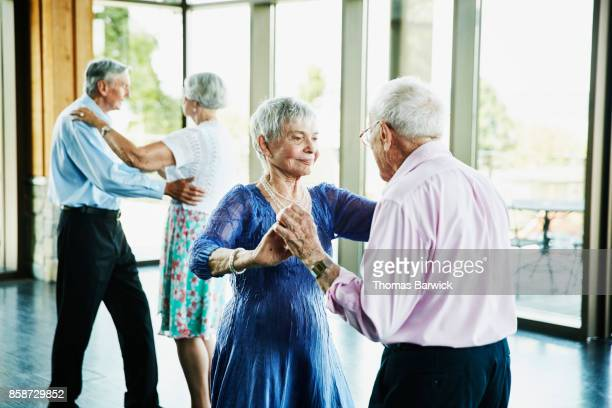 Senior couple dancing together in community center