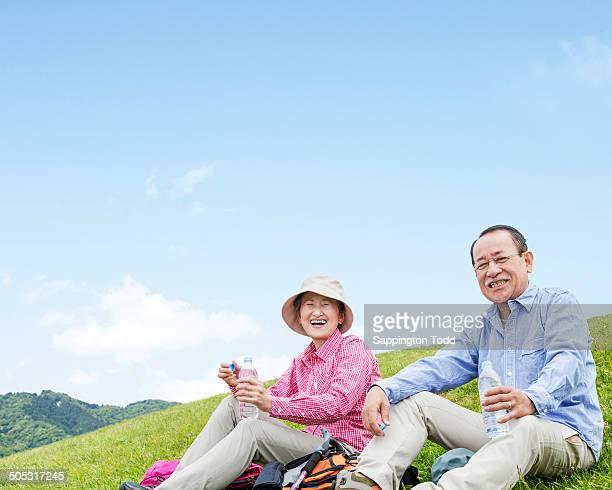 Senior Couple Dinking Water