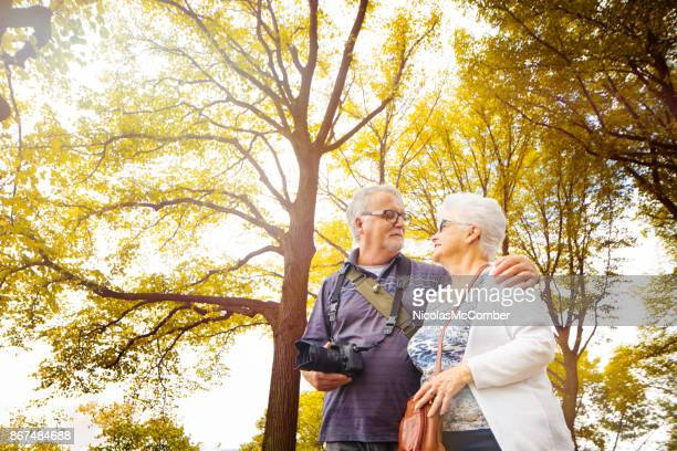 Senior couple discovering New-York City park in Autumn