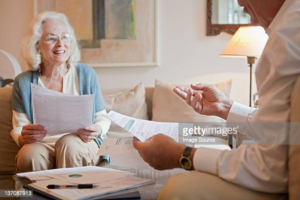 Senior couple discussing paperwork at home