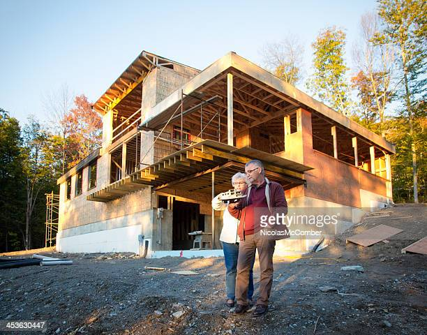Senior couple discussing the construction of new home