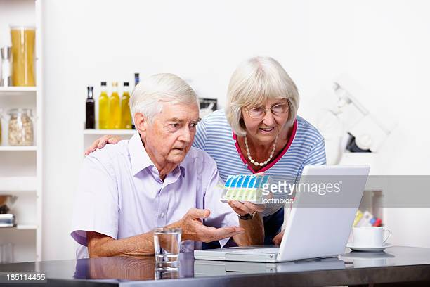 Senior Couple Dispensing And Reviewing Medication