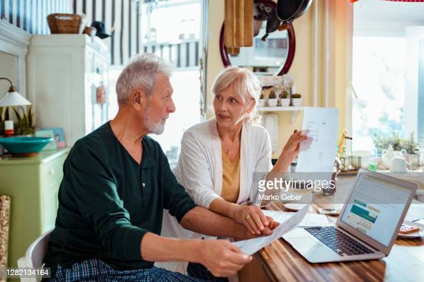senior couple doing home finances - vitality stock pictures, royalty-free photos & images