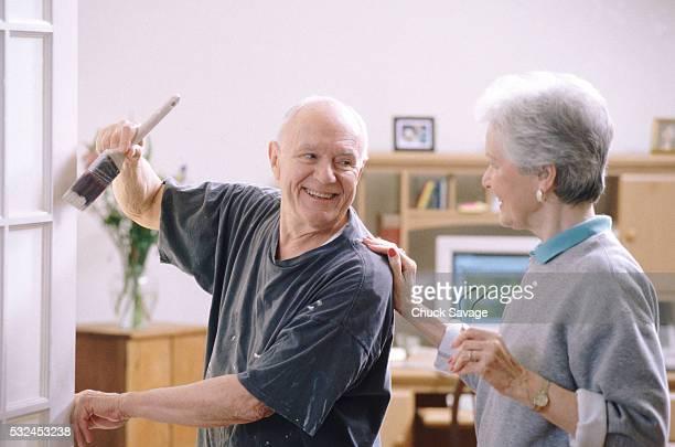 Senior couple doing home improvements