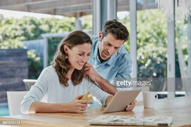 Senior couple doing online payment with credit card