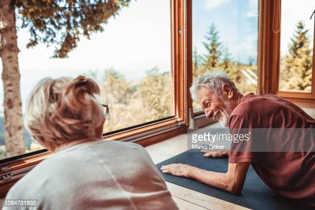 senior couple doing yoga - disruptaging stock-fotos und bilder