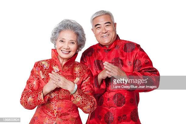 Senior Couple Dressed in Traditional Clothing Celebrating Chinese New Year