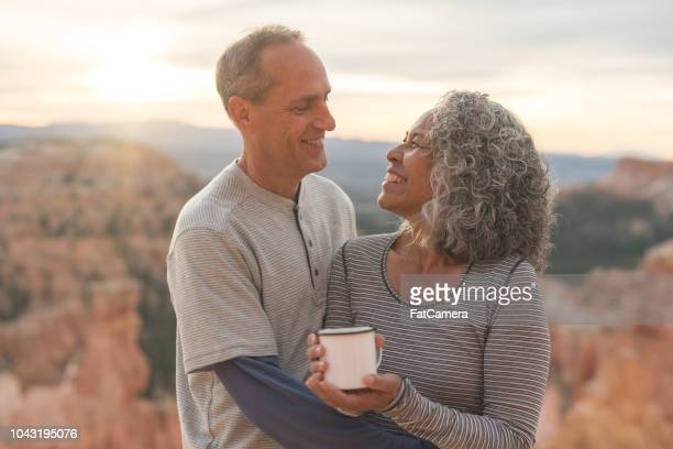 senior couple drink coffee together on a hiking adventure - coffee drink stock pictures, royalty-free photos & images