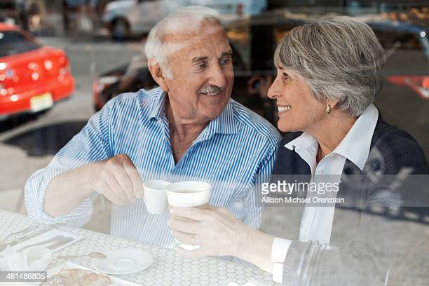 senior couple drinking coffee in cafe