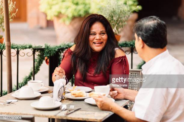 senior couple eating breakfast in mexican hotel - queretaro state stock pictures, royalty-free photos & images