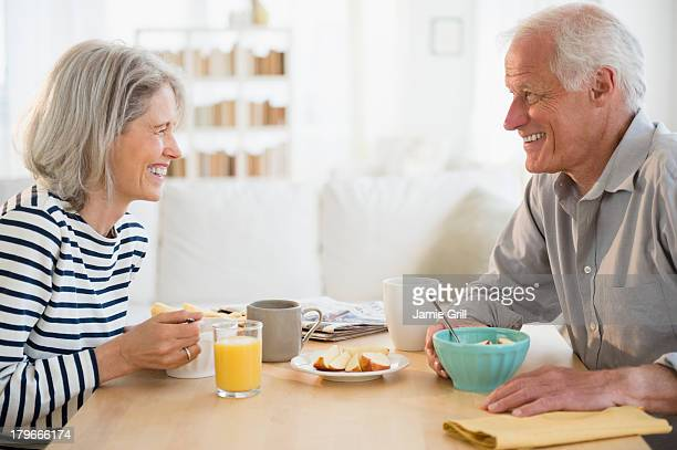 Senior couple eating breakfast together