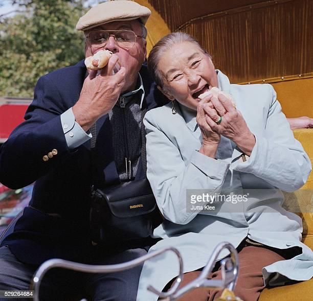 Senior Couple Eating Hot Dogs