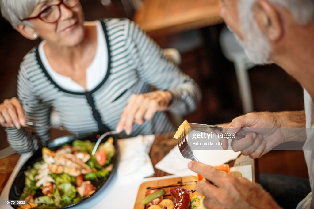 Senior couple eating in the restaurant : Stock Photo