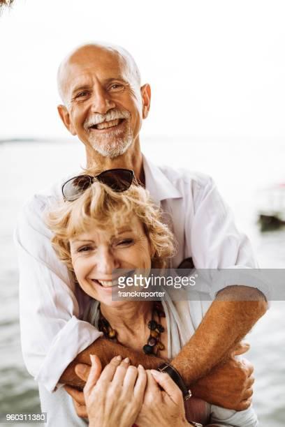 senior couple embraced at the seaside