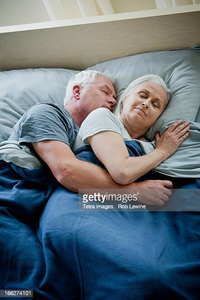 Senior couple embracing and sleeping