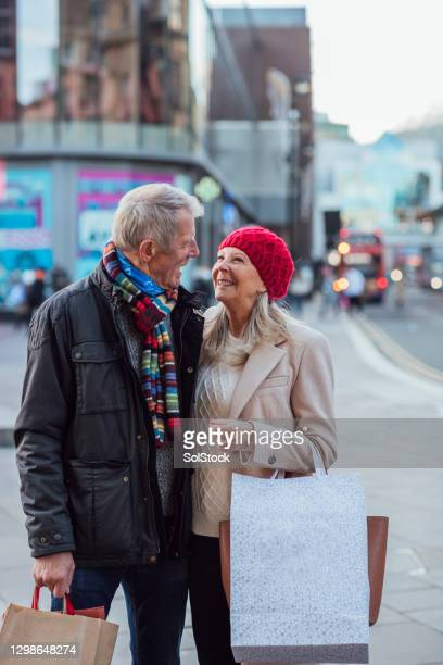 senior couple embracing in the city - newcastle upon tyne stock pictures, royalty-free photos & images