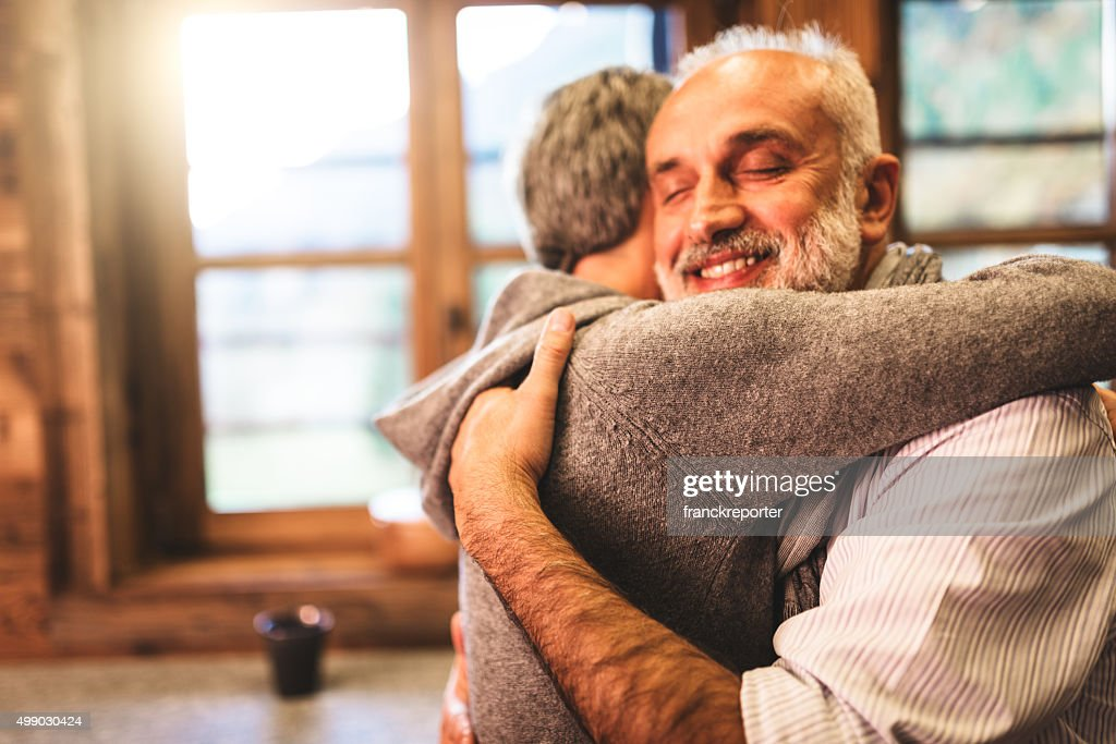 senior couple embracing passionate in the house - support concept : Stock Photo