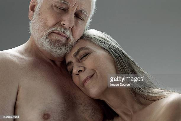senior couple embracing - female hairy chest stock pictures, royalty-free photos & images