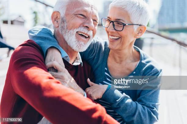 senior couple embracing - coppia anziana foto e immagini stock