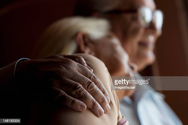 senior couple embracing - close up stock pictures, royalty-free photos & images