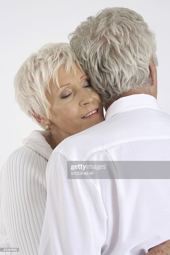 Senior couple embracing : Stock Photo