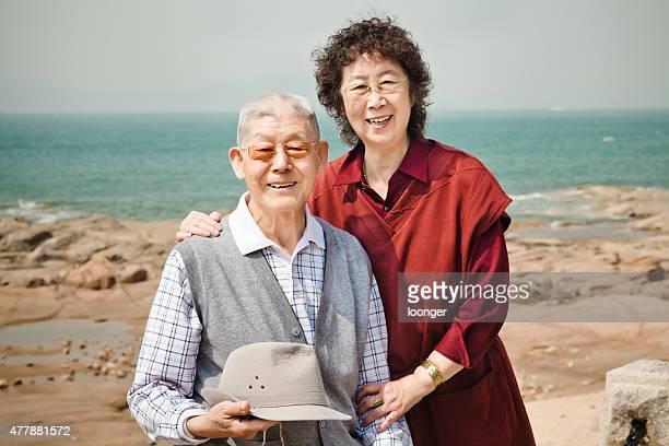 Senior couple enjoying a beautiful day at the seaside