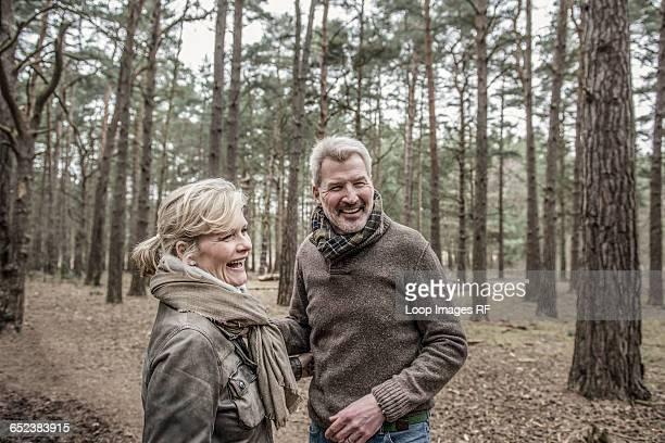 Senior couple enjoying a break during a woodland walk