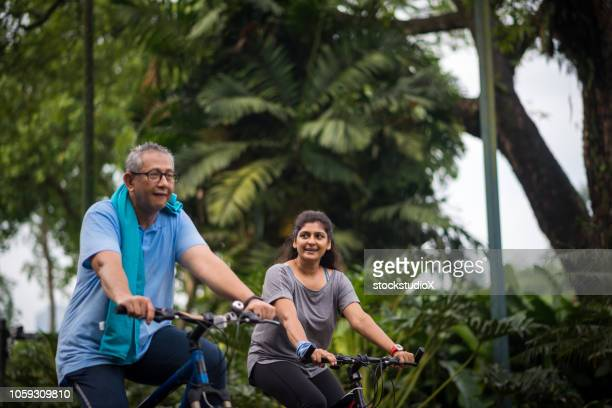 senior couple enjoying a healthy lifestyle - indian couples stock pictures, royalty-free photos & images