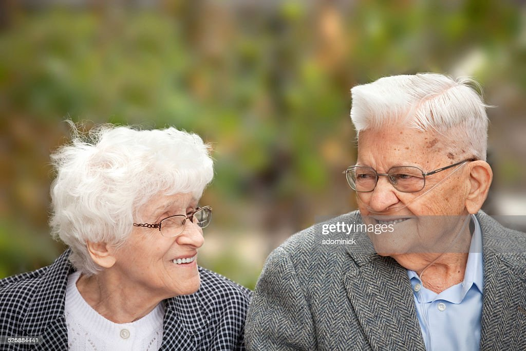 Senior Couple Enjoying A Laugh Together Outdoors : Stock Photo