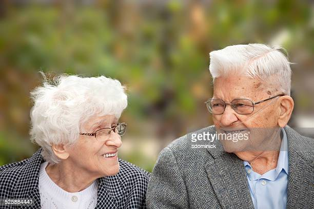 senior couple enjoying a laugh together outdoors - copd stock photos and pictures