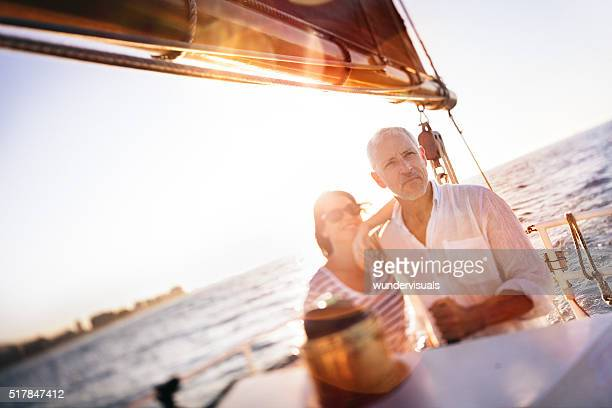 Senior couple enjoying a yacht cruise together