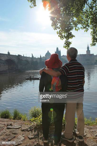 Senior couple enjoying beautiful scenery by the water's edge.