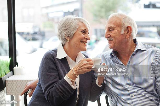 Senior couple enjoying coffee together in cafe