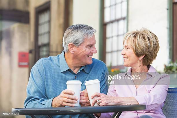 Senior couple enjoying cup of coffee