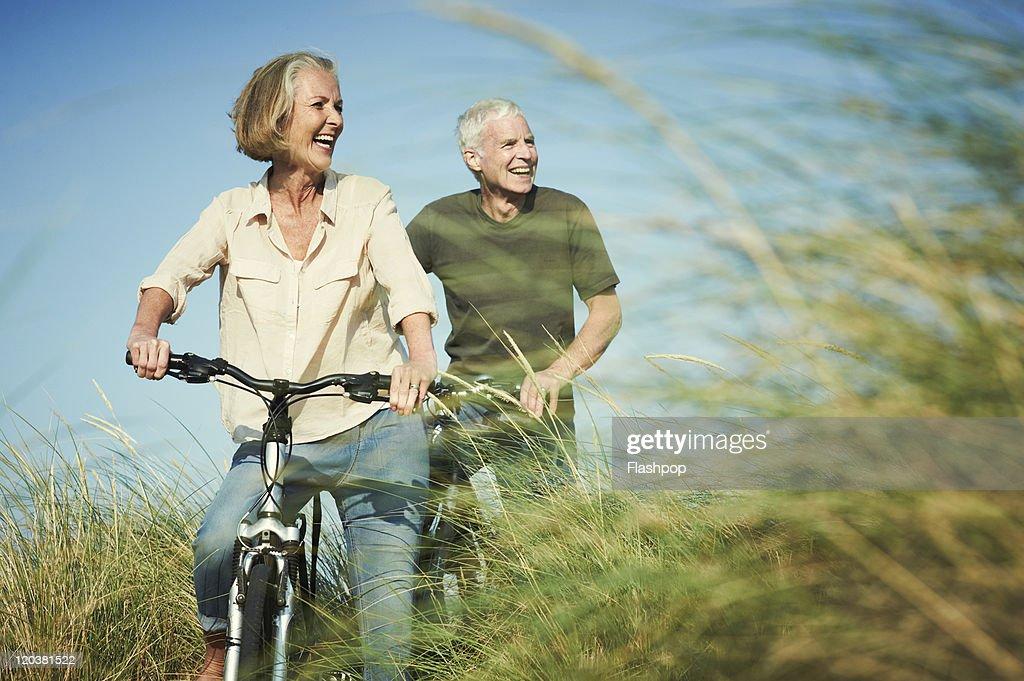 Senior couple enjoying day out on their bicycles : Stock Photo