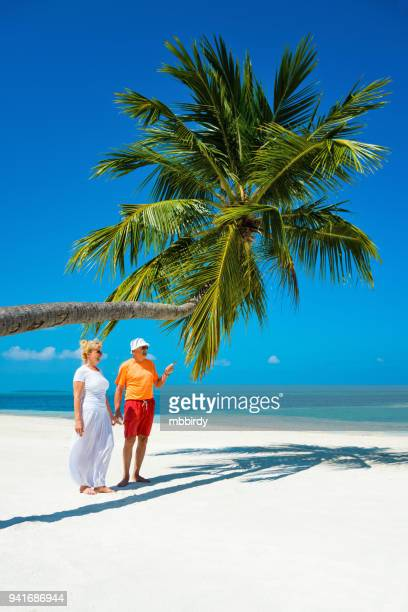 senior couple enjoying holidays at canareef resort maldives, herathera island, addu atoll - adults only stock pictures, royalty-free photos & images