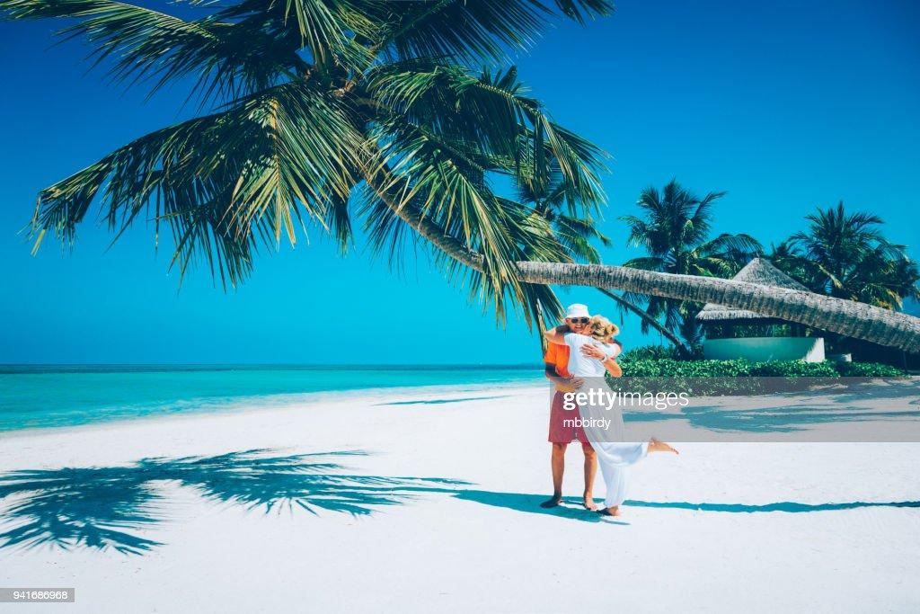 Senior couple enjoying holidays at Canareef Resort Maldives, Herathera island, Addu atoll : Stock Photo