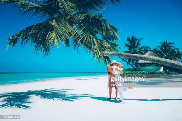 senior couple enjoying holidays at canareef resort maldives, herathera island, addu atoll - indian ocean stock pictures, royalty-free photos & images