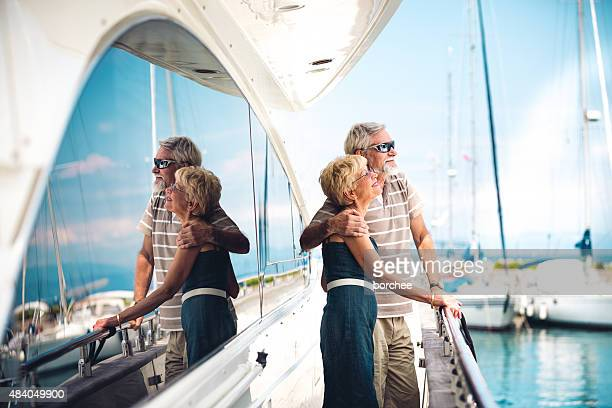 senior couple enjoying on vacations - yacht stock pictures, royalty-free photos & images