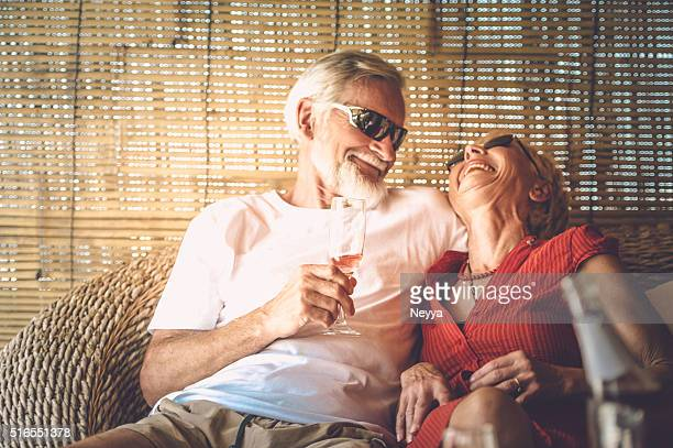 senior couple enjoying summer vacations with champagne - anniversary stock pictures, royalty-free photos & images