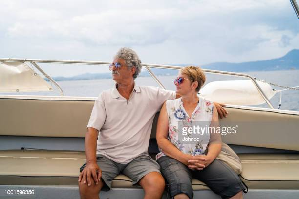 senior couple enjoying the ride on speed boat - passenger craft stock pictures, royalty-free photos & images