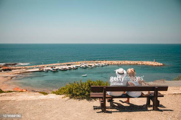 senior couple enjoying the view - republic of cyprus stock pictures, royalty-free photos & images