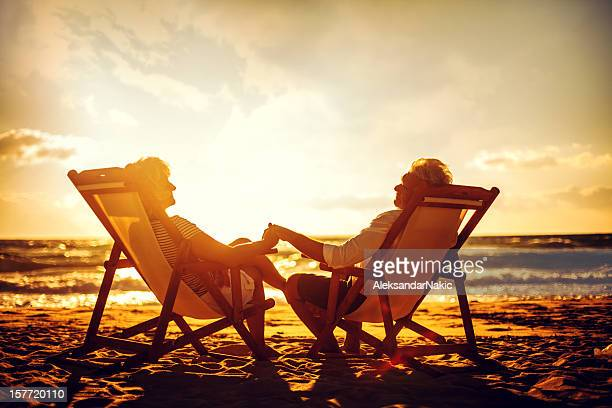 senior couple enjoying their golden years - gold meets golden stock photos and pictures