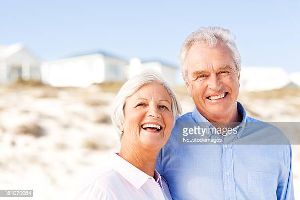 Senior Couple Enjoying Vacation On Beach