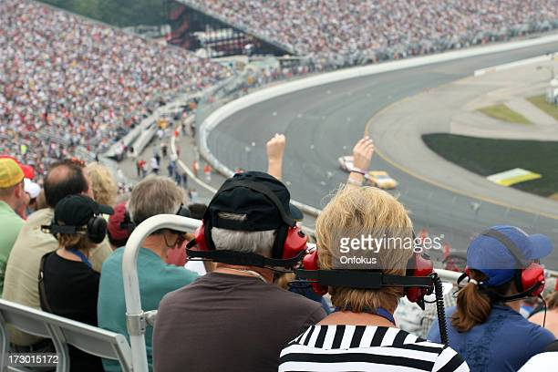 senior couple fans at racing event - motorsport stock pictures, royalty-free photos & images