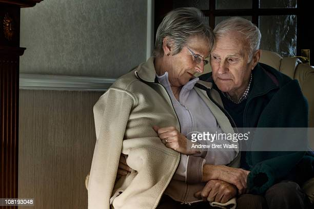 senior couple feeling cold in their home - temperature stock pictures, royalty-free photos & images
