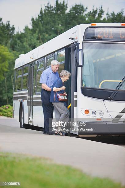 A Senior Couple Getting On The City Bus