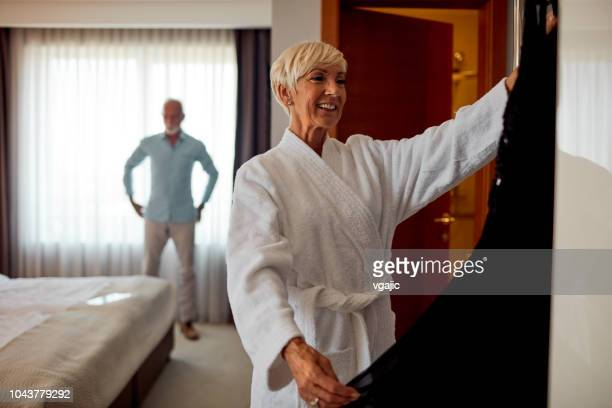 senior couple getting ready for new year party - grey dress stock pictures, royalty-free photos & images